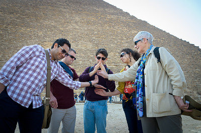 Jan. 13, 2013. Members from the travel group, Exodus travel, show how the great pyramids of Giza were built. From left; Nav, Paul, Enrico, Michal, and Ann.