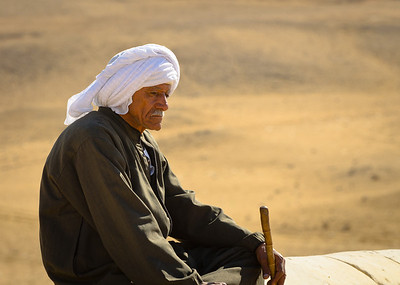 Jan. 13, 2013. An Egyptian man at the panorama of the great pyramids of Giza.