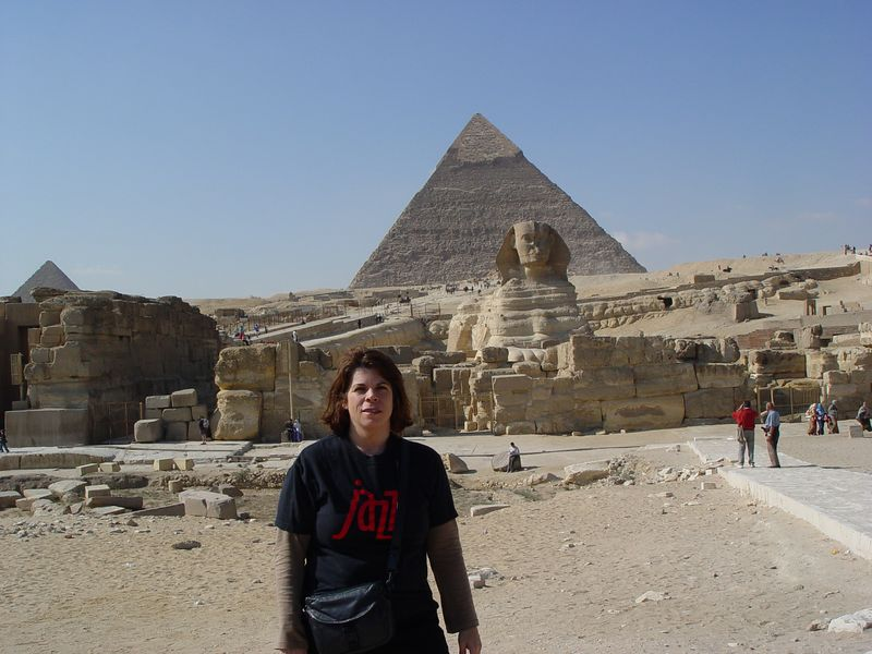 f) On our way to the sphinx, Alexis points out the Hard Rock Cafe Cairo.<br /> Here I am  posing in front of the Sphinx. The pyramid of Khafre is visible behind the sphinx.