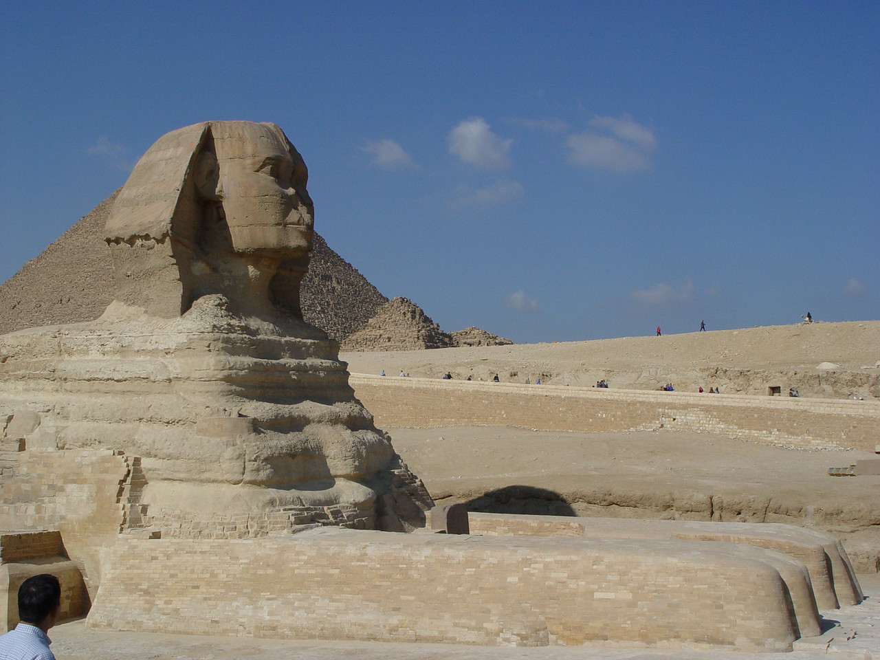 g) The Sphinx was carved out a natural outcropping of limestone. It's 241 feet/73.5 meters in length and reaches 65 feet/20 meters in height. The face is believed to be that of Khafre. What happened to it's nose? One popular story is that it was shot off by one of Napoleon's troopers. However, Frederick Lewis Norden, an artist and marine architect sketched the Sphinx in 1737. His detailed drawings, published in 1755, showed the Sphinx with no nose. It is very unlikely that he would omit the nose if it was present. We can conclude that the nose's removal can not be blamed on Napoleon's troops, who visited more than 50 years later.<br />  All throughout egypt though, we see many statues where the nose's have been removed. This was a common way of defacing statues.