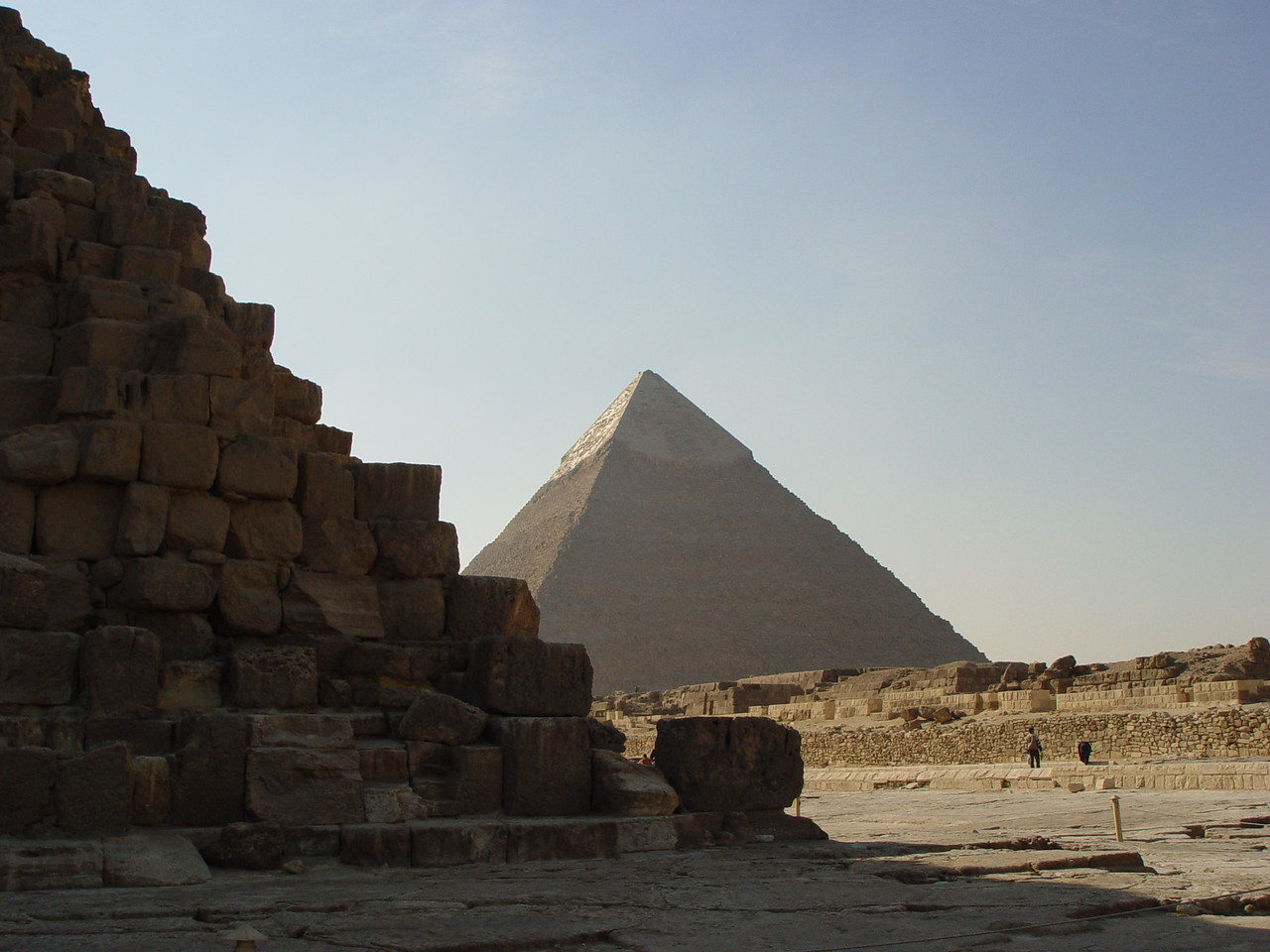 "b) The largest of the pyramids is one of the seven ancient wonders of the world. Commisioned by Khufu, a pharaoh of the 4th dynasty around the year 2560 BC.<br /> There were some buses of local children on a field trip. They ranged from about first grade to 6th grade. We were swamped by the kids and their curiosity. All yelling ""hello"", ""what is your name?"", and ""where are you from?"" Many of them wanted to have their picture posing with me."