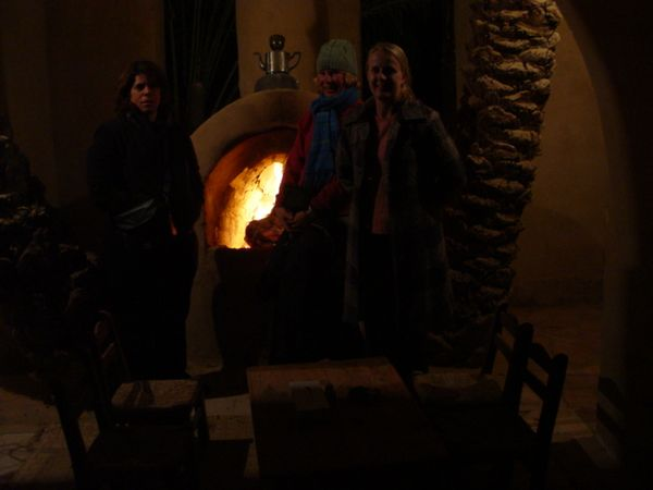 t) Posing by the fireplace, we have me, Jess, and Tracey.