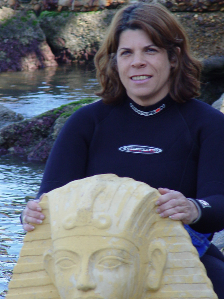 f) Here I am sitting on a sphinx while waiting to board the boat.