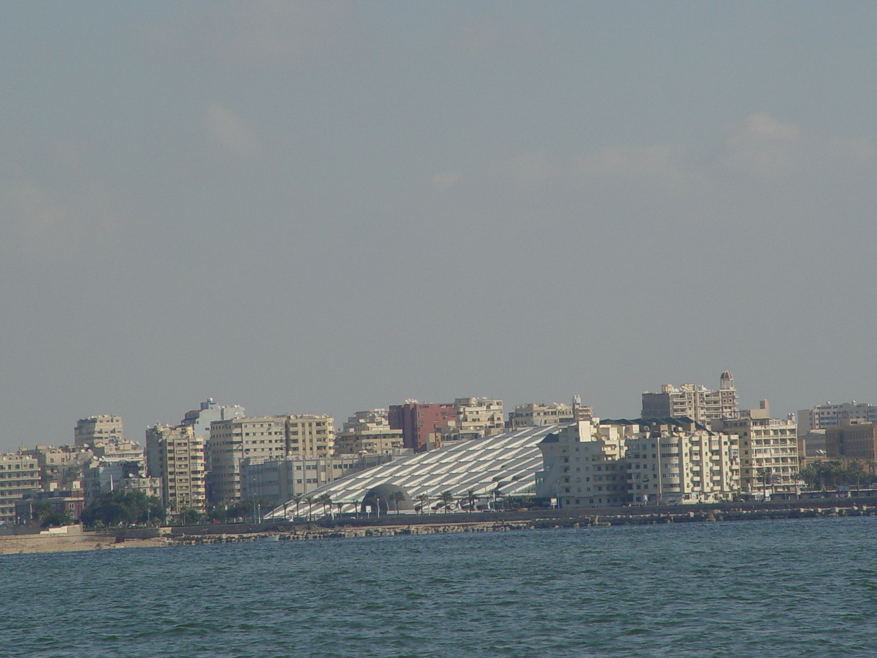 g) I take a photo of the new library from the harbor.