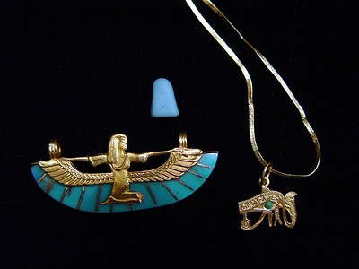 r) Isis pendant and Eye of Horus pendant bought from the Khan El Khalili. The small blue stone was found in Cleopatra's palace.