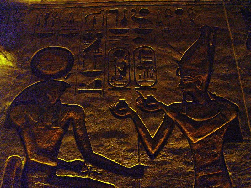"""f) This is Ramesses making an offering to Re-Horakhty<br /> Here is my best translation of the hieroglyphs.<br /> On the right side reading from left to right<br /> transliteration: Ntr nfr nb t3.wy wsr-m3't-r' stp-n-r' s3 r' nb kha? r'-ms-sw mry-imn di 'nh mi r'<br /> translation: the perfect god, lord of the two lands, """"powerful is the justice of Re, chosen of Re"""" (this is the pharoahs throne name in the first cartouche). The son of Re, lord of apparitions?Ramesses, beloved of Amun (this is the pharoahs birth name). Bestowed life like Re.<br /> On the left side reading from right to left<br /> transliteration: Dd mdw r' hr'hty a' ntr nb pt. di=n 'nh Dd w's.<br /> translation: Words spoken for Re-Horahkty, great god of the sky, given life, stability, and power. The egyptian hieroglyphs class I took at UCLA truly enhanced my visit to Egypt. I spent much more time viewing the temple inscriptions than any other tourist."""