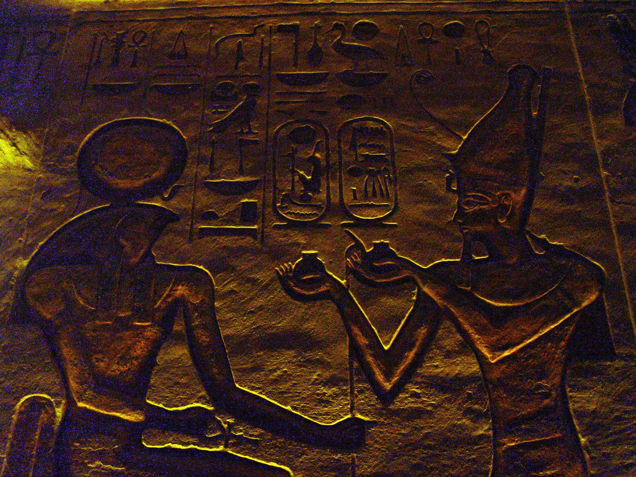 "f) This is Ramesses making an offering to Re-Horakhty<br /> Here is my best translation of the hieroglyphs.<br /> On the right side reading from left to right<br /> transliteration: Ntr nfr nb t3.wy wsr-m3't-r' stp-n-r' s3 r' nb kha? r'-ms-sw mry-imn di 'nh mi r'<br /> translation: the perfect god, lord of the two lands, ""powerful is the justice of Re, chosen of Re"" (this is the pharoahs throne name in the first cartouche). The son of Re, lord of apparitions?Ramesses, beloved of Amun (this is the pharoahs birth name). Bestowed life like Re.<br /> On the left side reading from right to left<br /> transliteration: Dd mdw r' hr'hty a' ntr nb pt. di=n 'nh Dd w's.<br /> translation: Words spoken for Re-Horahkty, great god of the sky, given life, stability, and power. The egyptian hieroglyphs class I took at UCLA truly enhanced my visit to Egypt. I spent much more time viewing the temple inscriptions than any other tourist."