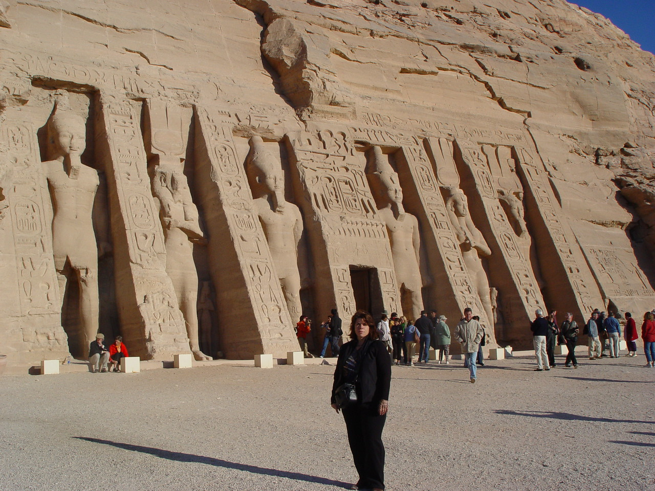 h) The Temple of Hathor was built to honor both Hathor as the goddess of love/music and Ramesses's wife Nefertari as the deified queen. There are six standing statues over 33 feet/10 meters high. Two statues of Ramesses flank one of Nefertari dressed as Hathor. His ego out does Nefertari, however, the fact that he made her proportional to himself is unheard of for a pharoah. This demonstrates that he truly loved her.