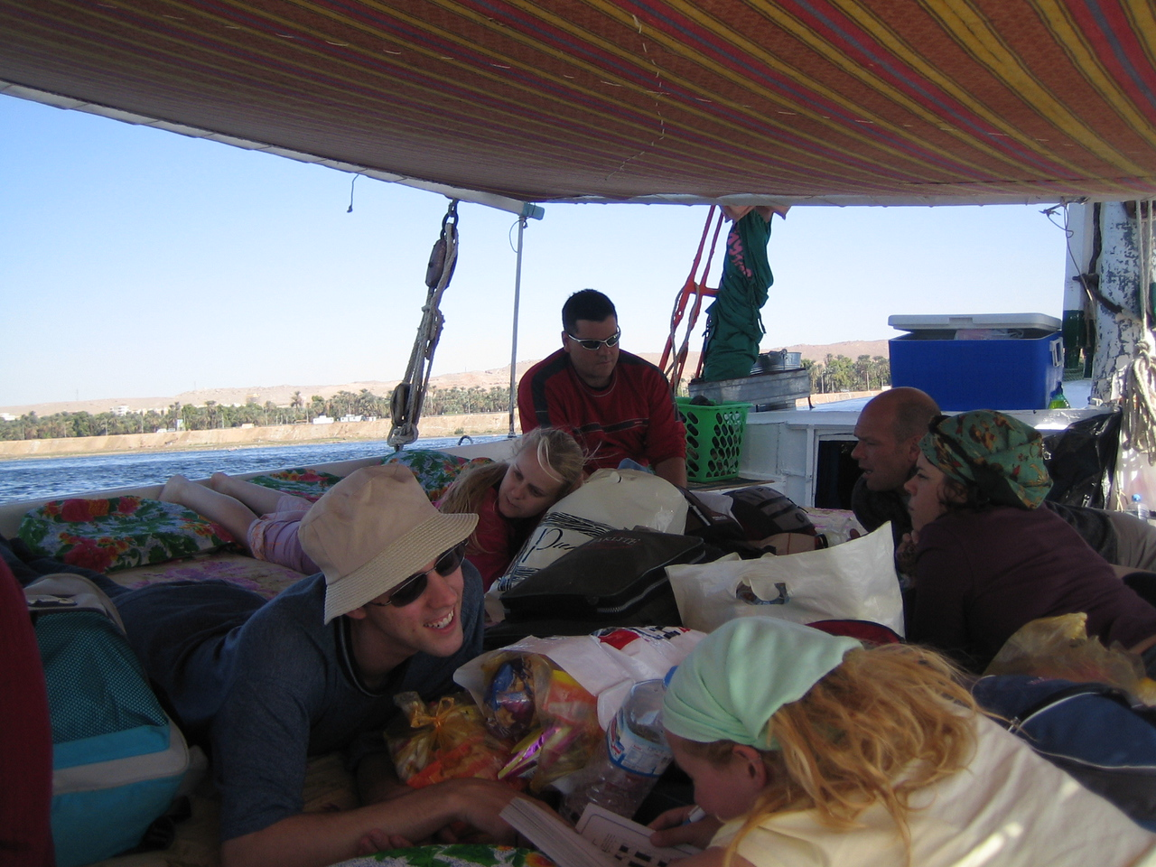 b1) First felucca night was pretty cold. They set up a canopy with sides to block the wind but it was still pretty cold. Someone comes up with the idea to tell stories, your most embarassing story. Brett starts with such an eloquent story involving a recent bus trip in Thailand, long mileage, great heat, bathroom needs and a chain of events that is so funny, and conjures images never to be forgotten, that we are left speechless with side splitting laughter. After the story ends there is long silence. I rack my brain through my entire life history to find a story to compete with that one, but no one can, the game is over.