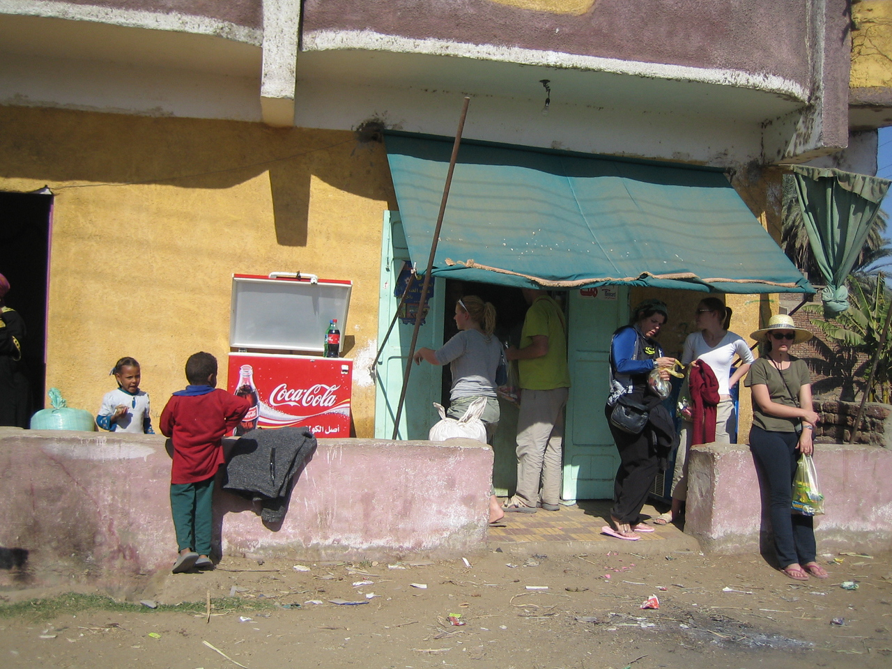 n2) We discover this house/shop which had chips and candies and go crazy buying snacks. We also use their house toilet ( I use the term toilet quite loosely here) and take turns sitting in line in their living room.