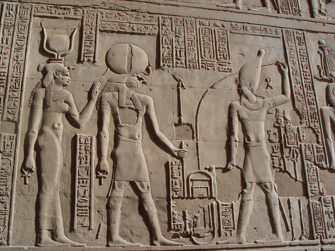 "d) We pull over to shore to visit the temple at Kom Ombo . It's a double temple dedicated to the crocodile god Sobek and the falcon god Haroeris (Horus the Elder). There are some mummfied crocodiles in one of the rooms.<br /> I pick up an unwanted guide at the temple. There are often locals who like to play egyptologist and show you around for some baksheesh (tips). Sometimes they'll show you a ""special"" area which is not opened for the tourists for baksheesh.<br />  Well I ended up reading the hieroglyph inscriptions to the guide to point out that I already know what the temple is about. I just wanted to quietly explore and read the inscriptions. He was nevertheless interested and would point to a cartouche and ask ""what is that"", I would read off Cleopatra or ptolomy etc. I'm sure he would use this information on the next tourist."