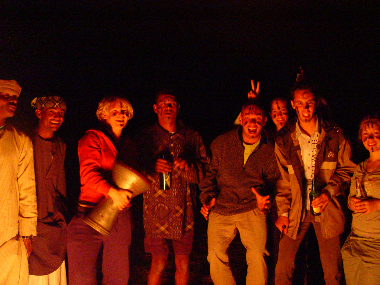 """p)I started the night with some beer.  . In this photo from left to right we have some crew members (can't remember his name), Abdu, Jess with drum, Mammoud """"Cheeky Monkey"""",  Tony, Megan, Brett, and Lisa. The term """"Survivor Felucca"""" is coined by Brett."""