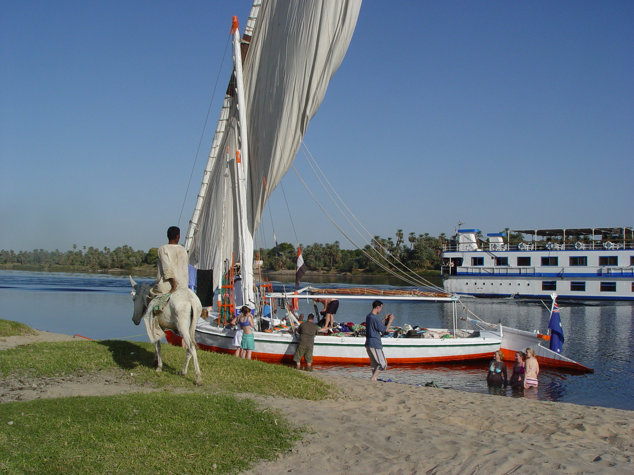 j) You can see the size of our felucca in this photo and the deck surface that we have been living on. It starts to look like a floating human rat's nest. But it was still a great time.<br /> There's this narrow plank you have to walk on to get off the boat. <br />  One of the local onlookers staring at the women in bikinis.