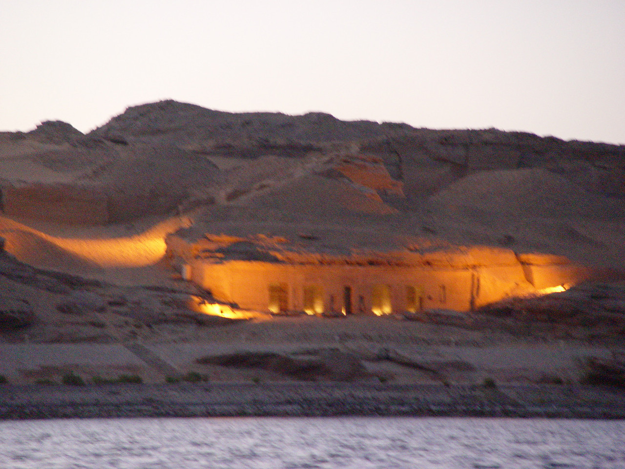 m) The tombs of Gebel el Silsila (Chain of Hills). I read about these in KMT journal (fall 2004 edition). Note: KMT is the transliteration for Kemet in ancient egypt. They didn't write vowels and Kemet is the true name of Egypt in ancient times, it means- the black lands, referring to the dark nile dirt. <br />  The major tomb of Gebel el Silsila is the speos Horemheb in this photo. Built and decorated by the last pharoah of the 18th dynasty (Horemheb), it was further enhanced by the Ramessides of the 19th dynasty. This is on the west side of the nile. On the east side are the quarries where  most of the limestone for the temples are cut.