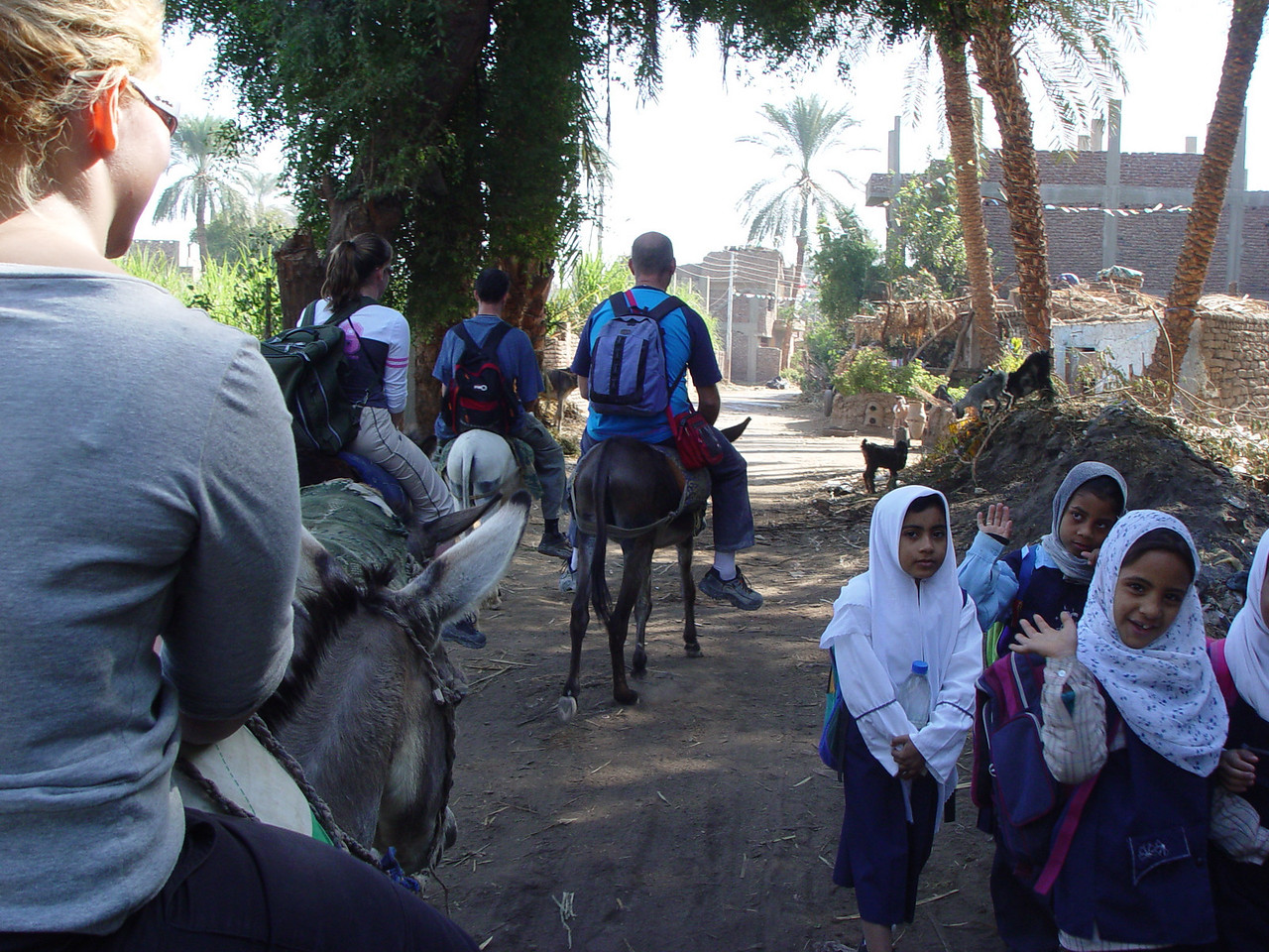 f) We ride back through villages, the children waive at us and love having their picture taken.