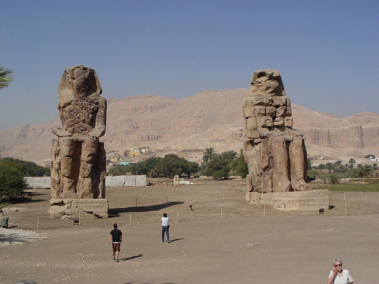 h) We ride pass the Colossi of Memnon. They were guards to a mortuary temple built by Amenhotep III (18th dynasty). The temple is gone but the guards remain. Due to an earthquake in 27 BC, a bell- tone would emanate from the statues which usually occurred in the morning due to rising temperatures and humidity. Early Greek travelers associated these with the figure of Memnon, the son of Aurora who's mother, Eos, was the goddess of dawn. To hear the sounds meant that you were favored by the gods. Visitors from miles, including Emperor Hadrian, in 130 A.D. came to hear these sounds.  The Roman emperor Septimius Severus in 199 AD tried to repair the statues and inadvertently silenced them forever.