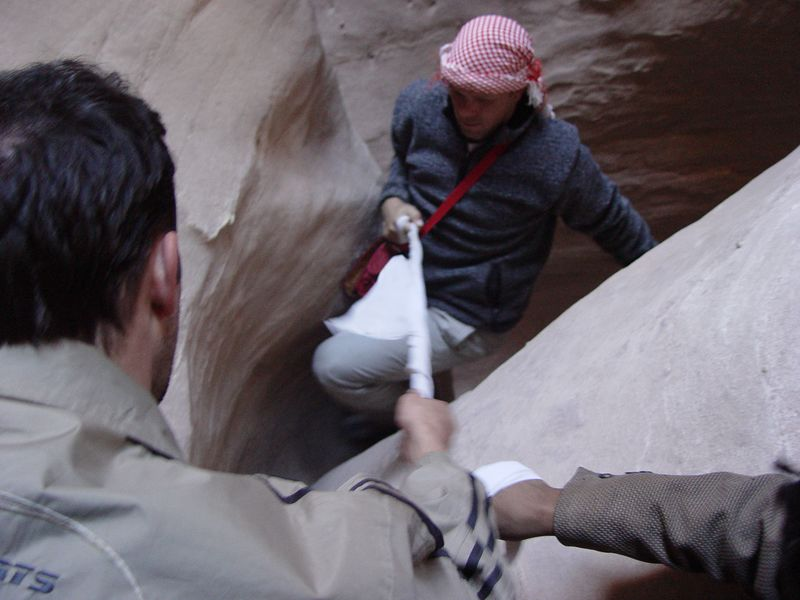 z) Brett helping Tony up a steep smooth area. No real hand or foot holds.