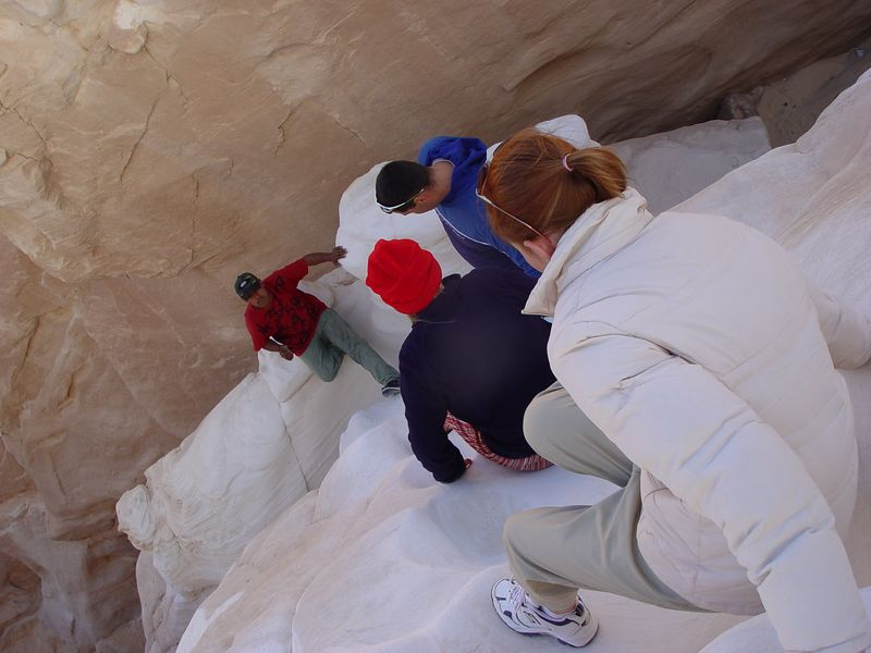 o) We discover that some climbing down into a canyon is part of the way to our oasis (Ein Khudra). The rocks are windworn smooth and white. The canyon is called sugar canyon because of the white sand.
