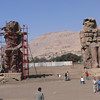 These are the Colossi of Memnon. They are all that is left of the Memorial Temple of Amenophis III. They are cut from two blocks of quartzite, which originated from a quarry near Cairo and stand 54.5 feet tall.