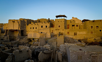 Jan. 22, 2013. Sunrise exposing the ruins of the ancient mudbrick town of Shali from the terrace of our villa we rented for a week in Siwa. Built in 1203 to house the 40 survivors of a tribal attack on the nearby settlement of Aghurmi, this walled, hilltop town protected the entire Siwan population for centuries. Though the houses were abandoned in 1926 after heavy rain, the steep maze of streets can still be explored, and several buildings have been rebuilt and restored.