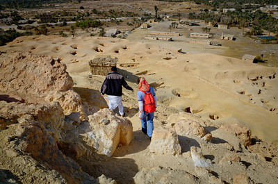 Jan. 22, 2013. Jeannette and Rahim climb down from the Mountain of the Dead overlooking the Siwa Oasis.