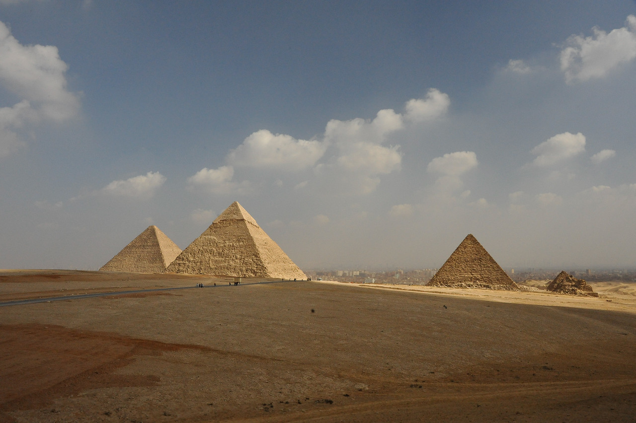 The Giza Plateau. The Great Pyramid of Khufu is to the far left.  The middle pyramid is the Pyramid of Khafre (son of Khufu). The Pyramid of Menkaure (aka Mycerinus; son of Khafre; southernmost) is to the right.