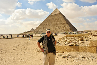 Ellis Mirsky on the Giza Plateau.  The Pyramid of Khafre (son of Khufu) looms in the background.  The Pyramid of Menkaure (aka Mycerinus; son of Khafre; southernmost) is the left.
