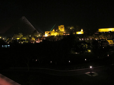 Great Pyramid of Khufu (left) at night from Mena Hotel at the foot of the Giza Plateau.  Pyramid of Khafre (son of Khufu) to the right.  Mena Hotel main building in front of pyramids.