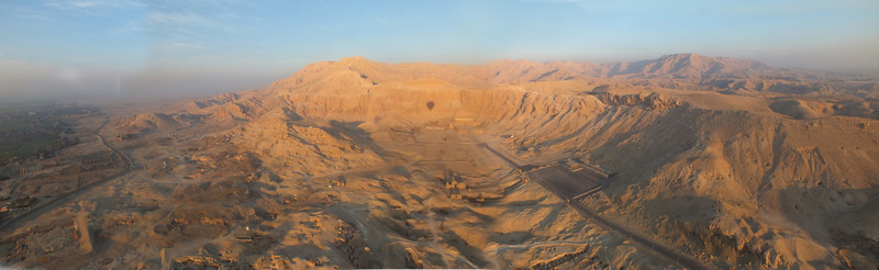A view from the Nile Valley to The Mortuary Temple of Hatshepsut onto to the hills that hide the Valley of the Kings where the greatest tombs are located.
