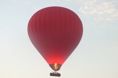 Heating up the balloon so it will rise.