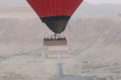 Under the basket is a view of The Mortuary Temple of Hatshepsut.