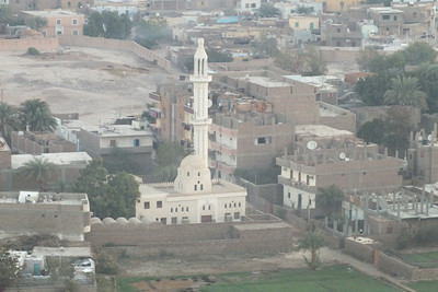 A mosque to the west but now closer and higher above it.
