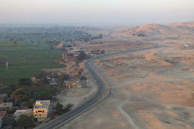 The road goes around theTemple of Ramesseum.