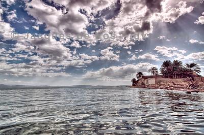 Assalah Beach - Dahab, Egypt  Assalha beach under a cloudy sky...