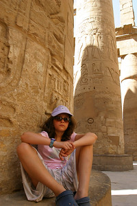 Anisa taking in the lecture.  We would stop in shaded spots where the guide would give us another dose of history.