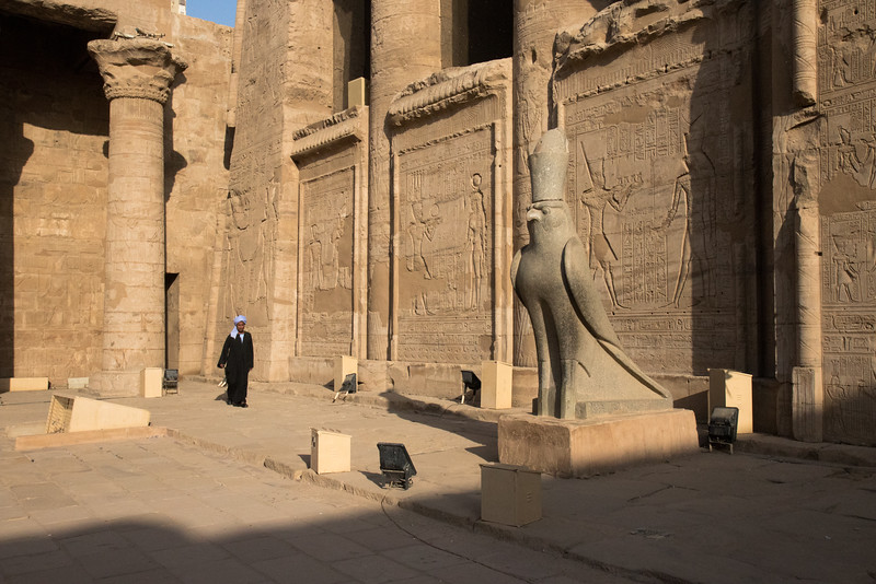 Statue of Horus inside the courtyard of the Temple of Edfu.  The temple of Edfu sits on the West bank of the Nile in the city of Edfu and is the largest temple dedicated to Horus.