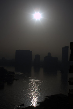This was the view outside our hotel the morning after we stayed in Cairo.  I didnt change the color or anything with this picture.  I dont know if this was smog or desert dust rolling it but it was surreal.  It cleared up a bit later but always looked a bit hazy.