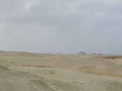 The Pyramids of Giza in the distant left side, Step Pyramid to the right.