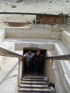 Caleb and Tanya climbing out of a pyramid.
