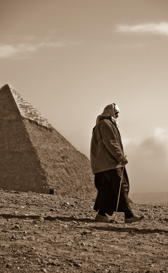 Man Hiking by Pyramids