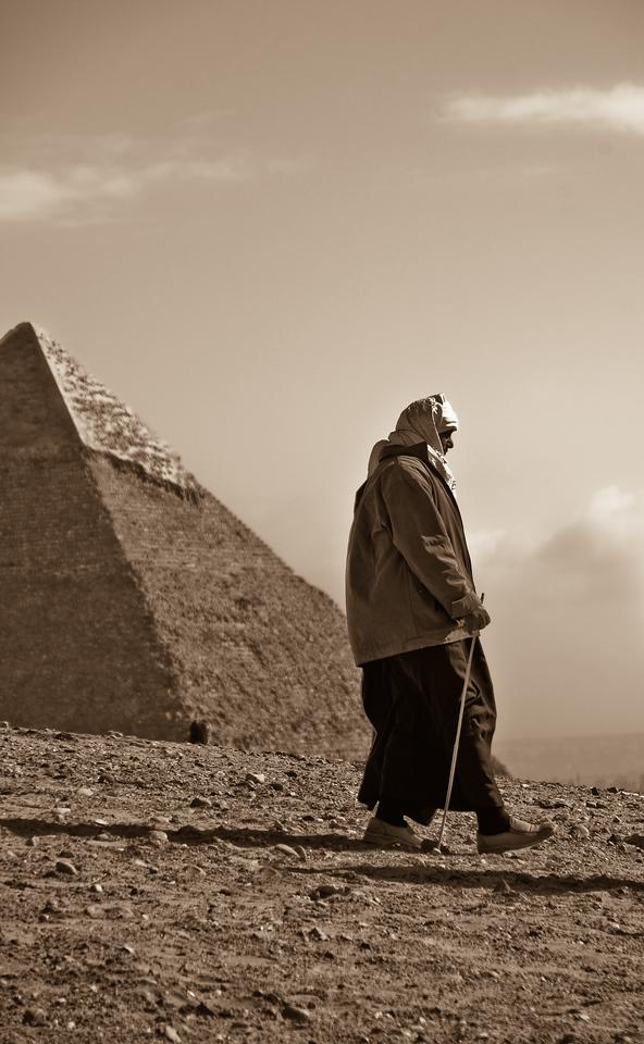 Man Hiking by Pyramids