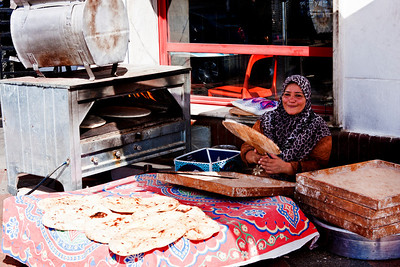 A woman we came across on the way to Giza, who was baking bread.  btw- it was about 95 degrees out.