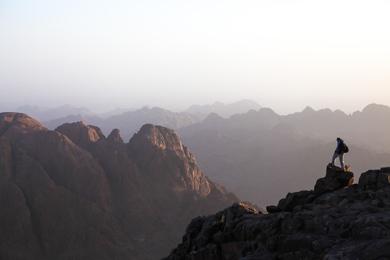 A Person Stands atop the Summit of Mt. Sinai at Sunrise