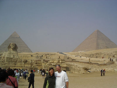Caleb and Tanya in front of the Sphinx and Pyramids of Giza.