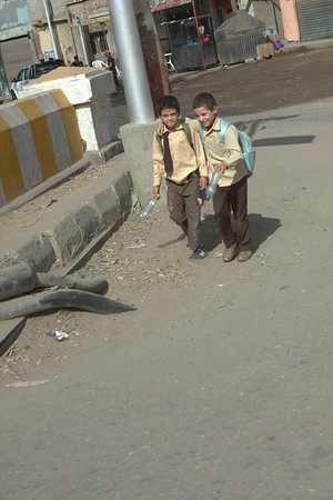 Two boys coming home from school.