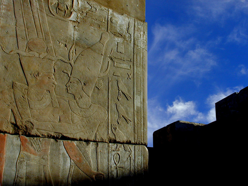 Pharaoh embracing the god Khnum; late afternoon shadows at the Temple of Satet on Elephantine Island, Aswan.