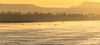 The golden first light of day casts its warm color on the Nile as a set of fisherman begin their day of work