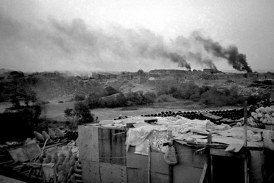 This was shot near the massive garbage heaps a bit to the south of Cairo.  People lived there and burned trash for fuel for their fires.