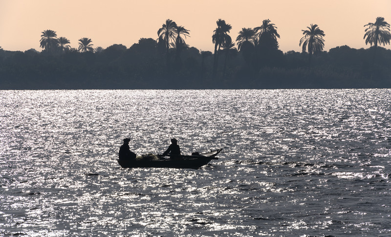 Fisherman silhouetted on the Nile