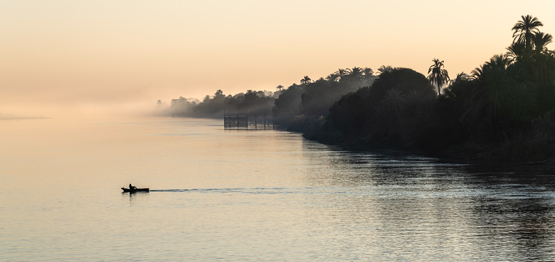 Sunrise along the Nile was always so peaceful and calm. 95% of the population of Egypt live within a few miles of the Nile River, it is the life blood of the country. Here, early one morning at the days first light I captured a lone man rowing across the Nile. Magic.